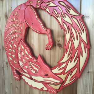 "Newest piece. The Hinterland Studio Fox logo! Drawing by UK artist Jane Beharrell. The image is a depiction of the ancient symbol ""Ouroboros"" which originally was the serpent eating its own tail, symbolizing wholeness or eternity. Transformed into wood using old growth yellow and red cedar, using a paint wipe technique that I made up to reveal the wood grain. The piece is 36""x36"". Really happy with how it turned out. Im really digging making art for peoples place of business. The vision of Raph for his studio was that he wanted his studio ""to be a place of inspiration for everyone who comes into it"" Im very happy to support that vision!! I'm also extremely grateful for the support from Hinterland Studio's in my work. Love <3 #wood #woodart #woodwork #woodmagic #wallhanging #woodmandala #woodworking #woodvibetribe #woodwhispering #handmade #handcrafted #hinterlandstudios #thelongdark #vancouverisland #cumberlandbc #customwood #craftsmen #oldgrowth #cedar #ouroboros"